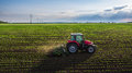 Tractor Spraying Field At Spring Royalty Free Stock Images - 71523989