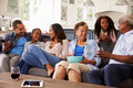 Multi Generation Black Family Talking Together While Watching TV Royalty Free Stock Photos - 71524618