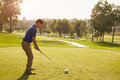 Male Golfer Lining Up Tee Shot On Golf Course Royalty Free Stock Photo - 71525175