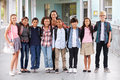Teacher Hanging Out With Group Of Elementary Kids At School Stock Image - 71526611