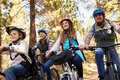Family Mountain Biking In A Forest, Low Angle Front View Royalty Free Stock Photo - 71529465