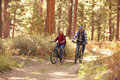 Senior Couple Cycling Through Fall Woodland Royalty Free Stock Photo - 71530585