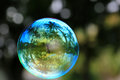 Floating Colorful Soap Bubble With Coconut Palms And Clouds Reflection, Macro Royalty Free Stock Photo - 71543065