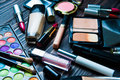 Various Makeup Products On Dark Background. Cosmetics Make Up Artist Objects: Lipstick, Eye Shadows, Eyeliner, Concealer Royalty Free Stock Image - 71585726