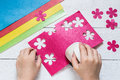 The Child Makes Special Hole Punch Flowers Of Paper Royalty Free Stock Photos - 71590918