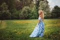 Beautiful Young Woman In Floral Blue Maxi Skirt Walking In Spring Royalty Free Stock Photos - 71655268