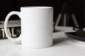 White Cup On A Table Stock Photos - 71670933