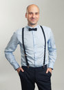 Fashionable Handsome Bald Man In Suspenders And Butterfly Tie Royalty Free Stock Photos - 71673218
