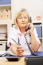 Doctor On Call In Her Office Stock Image - 71677811