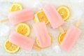 Pink Lemonade Popsicles With Lemon Slices On White Marble Stock Image - 71694721