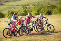Family Riding Bikes In The Mountains Royalty Free Stock Image - 71730326