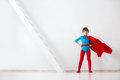 Leader. The Boy Super Hero In A Red Cloak. Royalty Free Stock Photos - 71730848