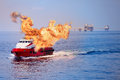 Fire Burning On The Boat In Offshore Oil And Gas Industry, Emergency Case And Firefighter Working For Protection Boat And Working Stock Image - 71742911