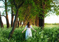 Pretty Young Woman In Long White Dress And With Long Golden Curl Stock Photography - 71759872