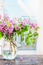 Lilac Flowers Bunch In Glass Vase On Window Still Royalty Free Stock Images - 71765119