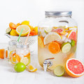 Detox Fruit Infused Flavored Water, Lemonade, Cocktail In A Beverage Dispenser With Fresh Fruits Stock Photos - 71769733
