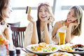 Young Group Showing Credit Card And Chatting In Restaurant Royalty Free Stock Photos - 71783048