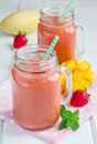 Healthy Smoothie With Strawberry, Mango And Banana In Glass Jars Stock Photos - 71790293