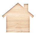House Shaped Paper Cutout On Natural Wood Lumber. Royalty Free Stock Images - 71798779