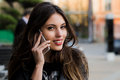Woman Phone Talking. Closeup Young Happy Beautiful Smiling Girl Lady Talking On Smartphone Over Cityscape Outdoor Street Royalty Free Stock Images - 71811959