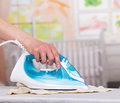 Woman S Hand Stroking  Clothes Steam Iron On  Background   Room. Stock Photos - 71909643