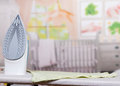 Steam Iron, Ironing Board And Clothes On Background Of  Room. Stock Photo - 71914220