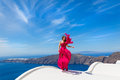 Woman In The Red Dress And Sea Stock Image - 71925741
