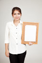 Asian Girl With Blank Paper Pin On Cork Board Stock Photos - 71931533