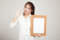 Asian Girl With Blank Paper Pin On Cork Board Stock Photos - 71932563