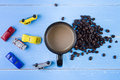 Coffee Cup With Coffee Beans And Toys Car On The Blue Wooden Bac Stock Image - 71935591