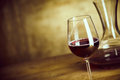 Single Glass Of Red Wine Alongside A Decanter Stock Photos - 71945853