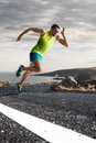 Male Runner Sprinting During Outdoors Training For Marathon Run Royalty Free Stock Photo - 71956535