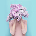 Woman Hiding Head In Bouquet Lilac Flowers Over Colorful Blue Royalty Free Stock Photos - 71957848