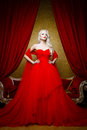 Fashion Shoot Of Beautiful Blond Woman In A Long Red Dress Stock Image - 71974561