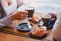 Coffee And Croissants In Cafe, Hands Of Couple In Restaurant Stock Photography - 71975222