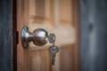 Knob, Key And Wooden Door On Gray Background Stock Images - 71994074