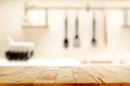 Wood Table Top (as Kitchen Island) On Blur Kitchen Background Stock Image - 71995051