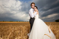 Just Married. Bride And Groom In Wheat Field With Dramamtic Sky Stock Image - 72045721