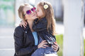 Fashionably Dressed Mother And Daughter On The Street In The Spring Stock Photos - 72051323