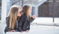 Fashionably Dressed Mother And Daughter On The Street In The Spring Stock Photos - 72051393