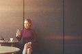 Young Woman Using Her Smart Phone While Is Sitting In Contemporary Coffee Shop Royalty Free Stock Photo - 72051765