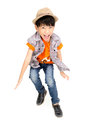 Asian Cute Boy Is Jumping With Smile Face Royalty Free Stock Image - 72052636
