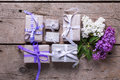Wrapped  Gift Boxes With Presents  And Lilac Flowers Royalty Free Stock Images - 72087679