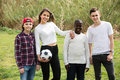Girl And Three Boys Playing Football In Spring Park And Smiling Stock Images - 72122614