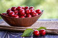 Fresh Cherries In Bowl On Table Stock Photos - 72146463