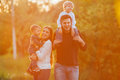 Young Family With Children Walking In Park. Father, Mother And Two Sons Royalty Free Stock Photo - 72147845