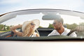 Happy Man And Woman Driving In Cabriolet Car Stock Photos - 72197813