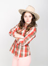 Beautiful Curly Girl In Pink Pants, A Plaid Shirt And Cowboy Hat. Stock Photos - 72231063