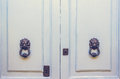 A Pair Of Old Metal Lion Head Knockers On Light Blue Doors Stock Image - 72245111