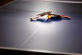 Two Table Tennis Or Ping Pong Rackets And Ball On A Blue Table W Stock Photo - 72266160